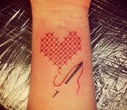 Cross Stitch Tattoo